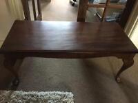 Dark brown wooden coffee table