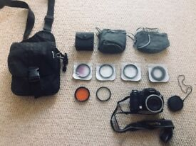 Fugi film camera with various lenses, great condition other than having to tape battery flap closed