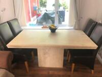 Marble table with six leather chairs