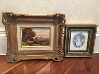 Pair of gilt frames with classic style pictures