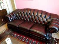 Burgundy Chesterfield settee with 2 matching armchairs with footstool
