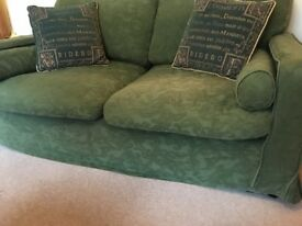 Pair of matching sofas with removable cotton loose covers