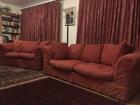 Matching terracotta red sofas