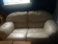 Large cream two seater leather sofa and electric reclining chair
