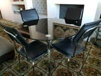 Black glass round dining table and 4 chairs
