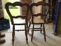 Two very old wooden chairs