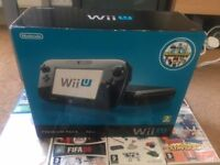 Boxed Black Nintendo Wii U 32GB Deluxe + 10 Games in Excellent condition