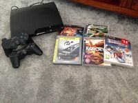 PlayStation 3 with two controllers and five games