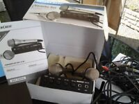 Only taken out of box brand new karaoke machine with 2 mics just plugs in tv