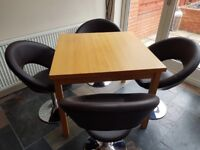 Extendable wooden table with chocolate brown faux leather retro dining chairs