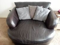 LARGE LEATHER CUDDLE CHAIR & FOOTSTOOL INCLUDES FREE DELIVERY.