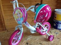 Girls barbie bike as new with brand new helmet