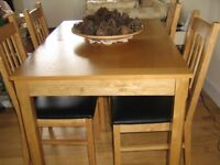 KITCHEN/D. ROOM EXTENDABLE TABLE & 4 CHAIRS,G. CON EXCEPT FOR ONE CORNER OF TABLE VENEER HAS COME OF