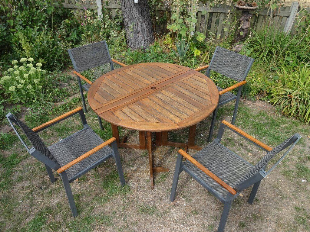 Large garden set teak table and 4 hartman chairs