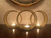 A beautiful Mat Gold 3 Circle pierced metal Candle Holder…great condition 38.5cm's Width.