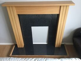 Beech laminate fire surround and hearth.