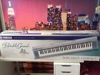 YAMAHA PORTABLE PIANO-STYLE KEYBOARD