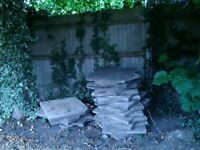 Approx 65 used 2x2ft grey paving slabs