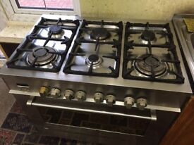 Delongi cooker 6 buner hob with electric large oven