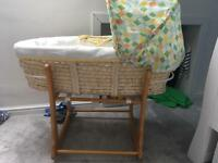moses basket and rocker stand and two fitted sheets