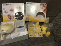 Breast pump & breast pads