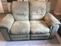Olive green sofa with pull out leg rest
