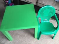 Green lack ikea table and childrens plastic chair