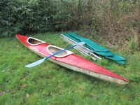 two-person fibreglass canoe and paddle