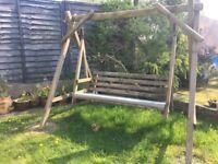 Rustic wooden garden swing