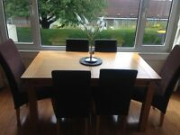 Beech wooden extendable dining table including 6 chairs