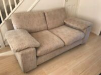 Two seater fabric sofa in brown