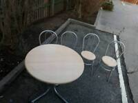 For sale round top table and four chairs sale. ?