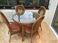 CANE TABLE AND FOUR CHAIRS, GOOD CONDITION.