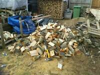Large net bags of seasoned hard wood logs and kindling