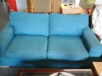 Nearly New teal material 3 seater sofa