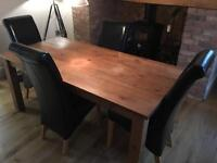 Dining room table and 6 black chairs
