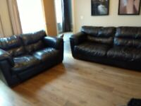 Pair of large leather sofas