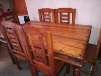 Solid wood (shesham) table and 6 chairs,