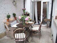 A beautiful Wooden stylish Chair/Sofa and two Wodden folding tables to sale