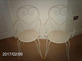 cream metal chairs