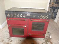 RANGEMASTER cooker in BURGUNDY. Inherited in good order with a house sale. Stored 18 monthsoths