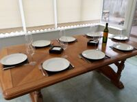 Large wooden extendable 6-8 seater table.