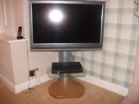 "Toshiba 37"" television on modern swivel stand"