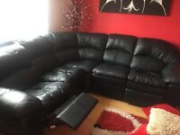 Black leather corner suite with recliners