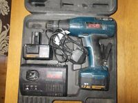 RYOBI CORDLESS DRILL. CHARGER AND TWO BATTERIES. SPARES OR REPAIR.