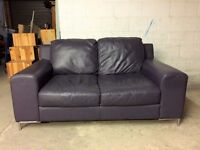 Two 2 seater leather sofas and large footstool