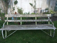 A 6ft6ins long Victorian slatted wood and metal garden seat