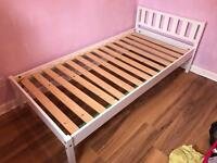 Single white bedframe with optional waterproof mattress