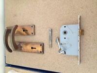 Brass door handles and lockable latches