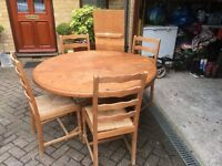 Extendable pine circular dining/ kitchen table with 4 chairs